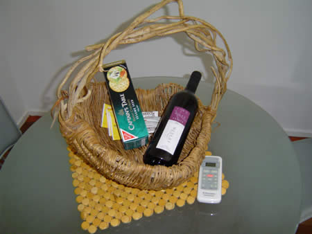 A basket with wine and biscuits