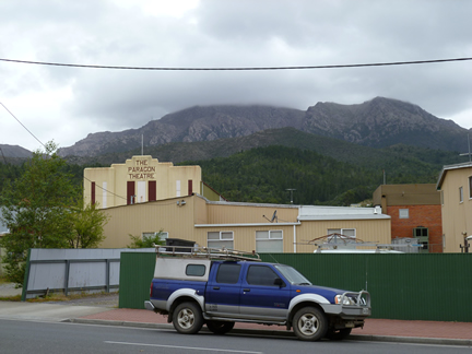 A photo of the Paragon Theatre in Queenstown with Mount Owen in the background